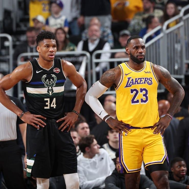 Giannis Antetokounmpo standing next to LeBron James
